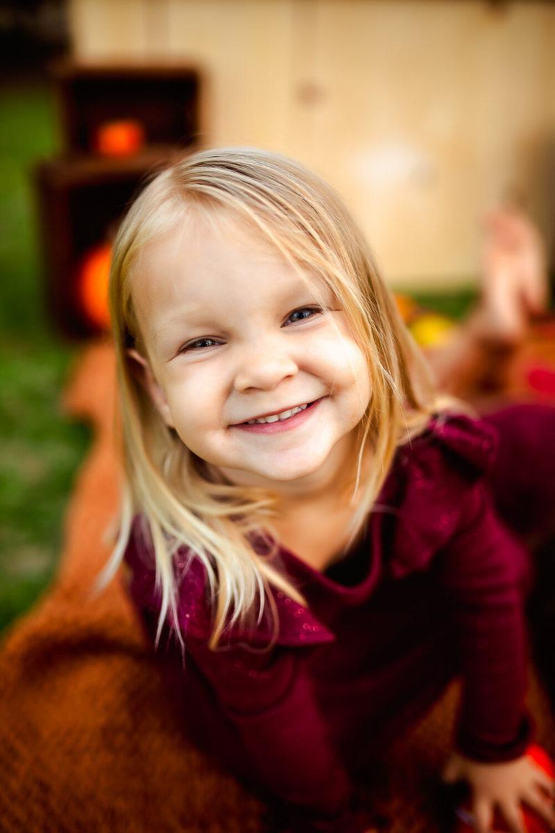 little girl in red fall dress