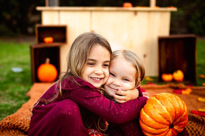 two sisters hugging